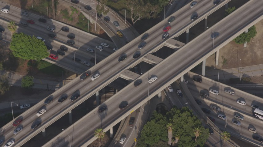 4K stock footage aerial video of a bird's eye view of heavy traffic on the I-110 / 101 freeway interchange, Downtown Los Angeles, California Aerial Stock Footage | AX43_041