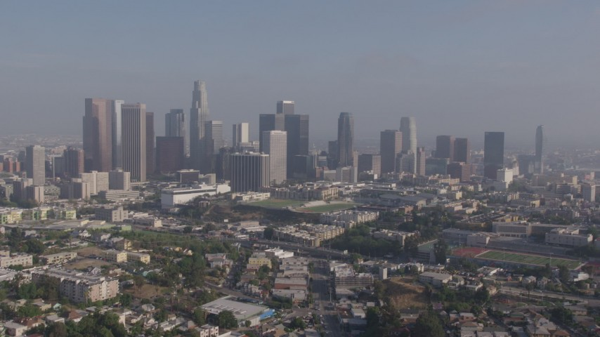 4K stock footage aerial video approaching the towering skyline of Downtown Los Angeles, California from Westlake Aerial Stock Footage | AX43_044