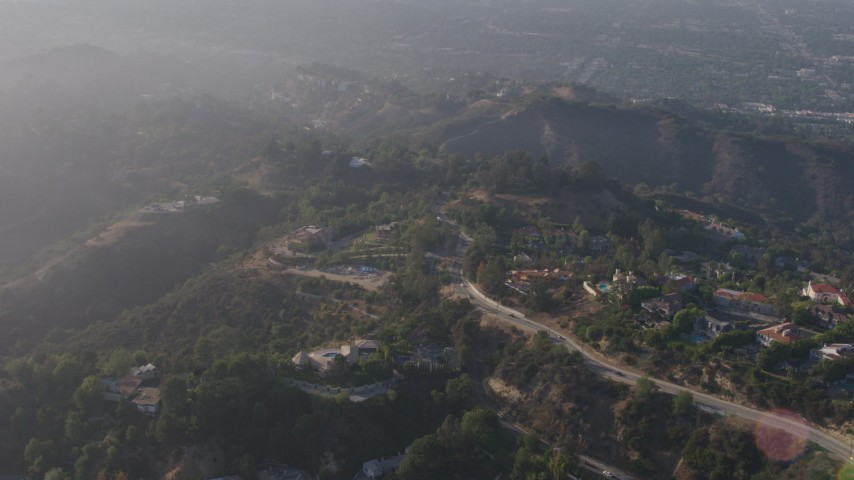 4K stock footage aerial video passing by hilltop mansions in Beverly Hills, California Aerial Stock Footage | AX43_062