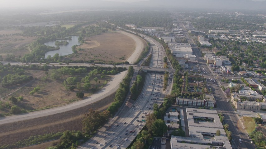 4K stock footage aerial video following heavy I-405 traffic by Woodley Park, Van Nuys, California, approach the Burbank Boulevard overpass Aerial Stock Footage | AX43_065