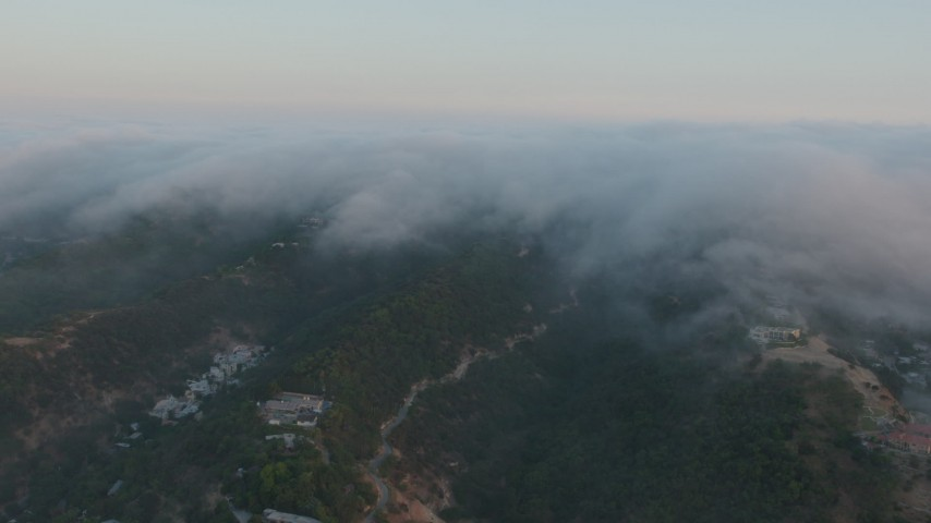 4K aerial video of fog rolling in over the hills in Sherman Oaks, California, sunset Aerial Stock Footage | AX44_005
