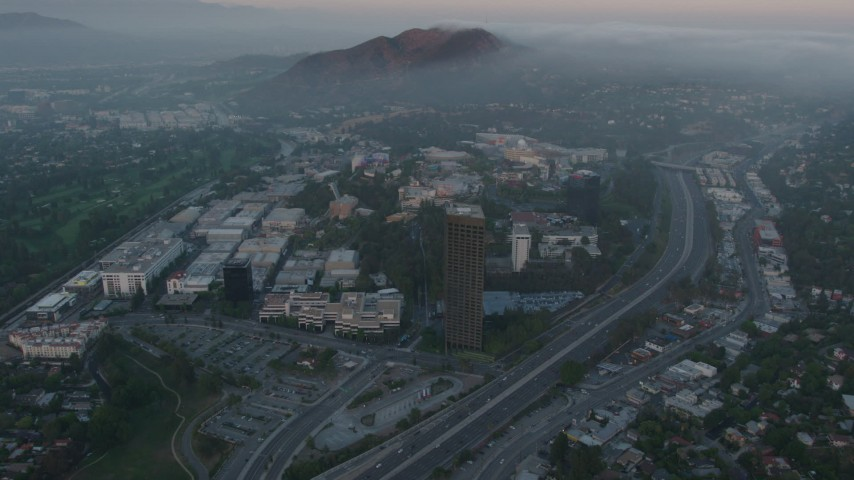 4K stock footage aerial video of fog rolling in near Universal City, Universal Studios, California, sunset Aerial Stock Footage | AX44_018