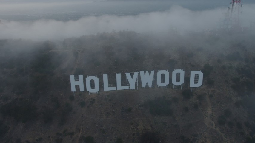 4K aerial video flying through marine layer revealing Hollywood Sign, California, sunset Aerial Stock Footage | AX44_027