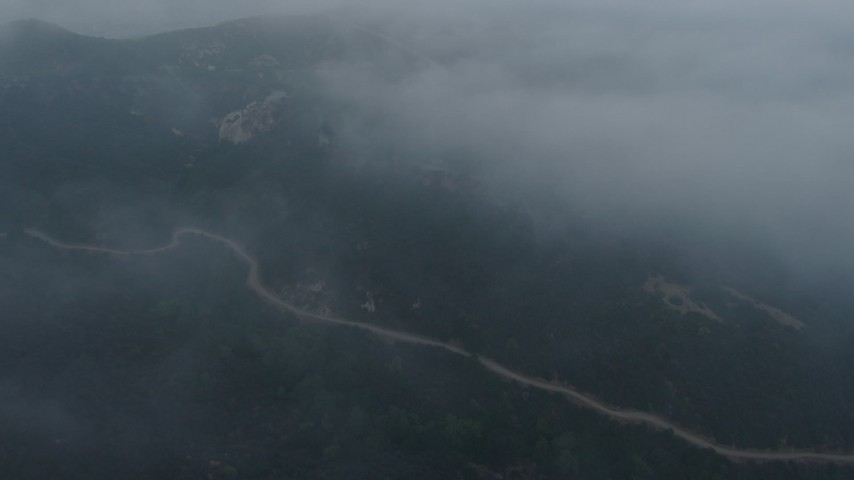 4K stock footage aerial video of winding roads in fog, Hollywood Hills, California, sunset Aerial Stock Footage | AX44_029