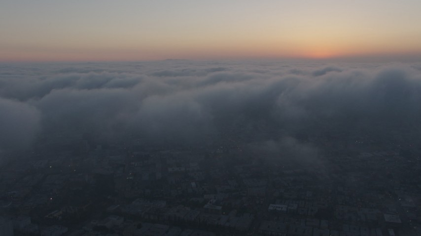 4K stock footage aerial video flying above thick marine layer, Hollywood, California, sunset Aerial Stock Footage | AX44_035