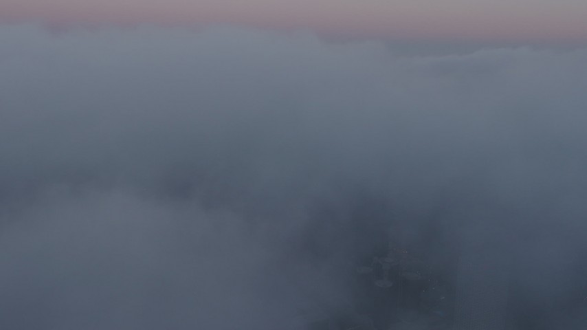 4K stock footage aerial video approaching city covered in fog, Los Angeles, California, twilight Aerial Stock Footage | AX44_036