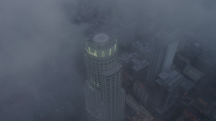 4K stock footage aerial video of a bird's eye of US Bank Tower through marine layer, Downtown Los Angeles, twilight Aerial Stock Footage | AX44_038