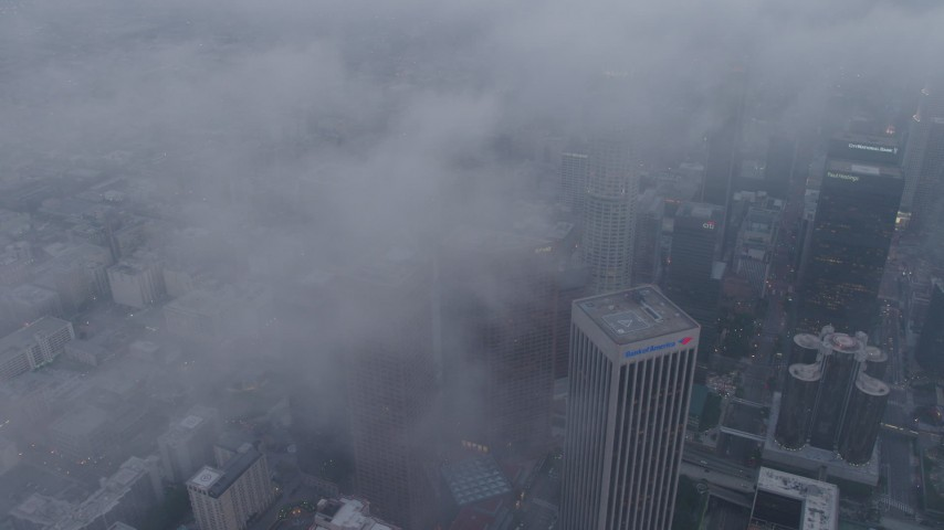 4K stock footage aerial video of skyscrapers coverd in marine layer, twilight, Downtown Los Angeles Aerial Stock Footage | AX44_040