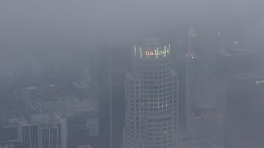 4K stock footage aerial video of US Bank Tower covered in marine layer, twilight, Downtown Los Angeles Aerial Stock Footage | AX44_041