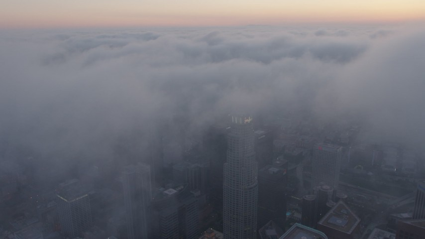 4K stock footage aerial video of city covered in marine layer, Downtown Los Angeles, sunset Aerial Stock Footage | AX44_042