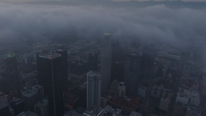 4K stock footage aerial video of a city covered in marine layer, Downtown Los Angeles, sunset Aerial Stock Footage | AX44_043