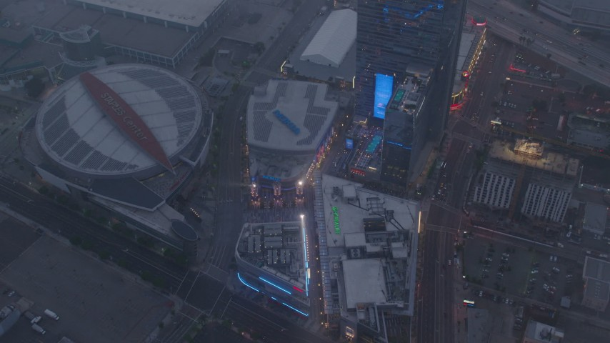 4K stock footage aerial video of a wide shot of Staples Center and Nokia Theater, Downtown Los Angeles, twilight Aerial Stock Footage | AX44_046