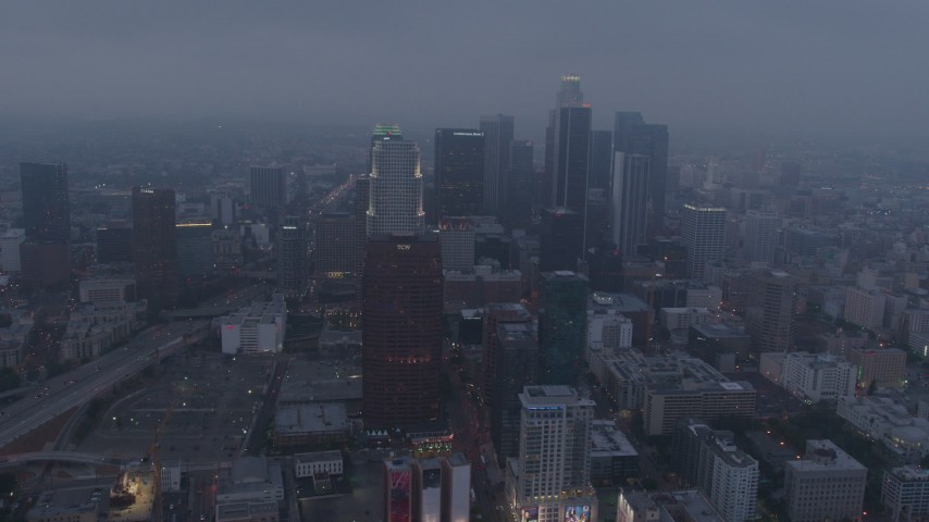 4K stock footage aerial video of skyscrapers through marine layer, Downtown Los Angeles, twilight Aerial Stock Footage | AX44_047