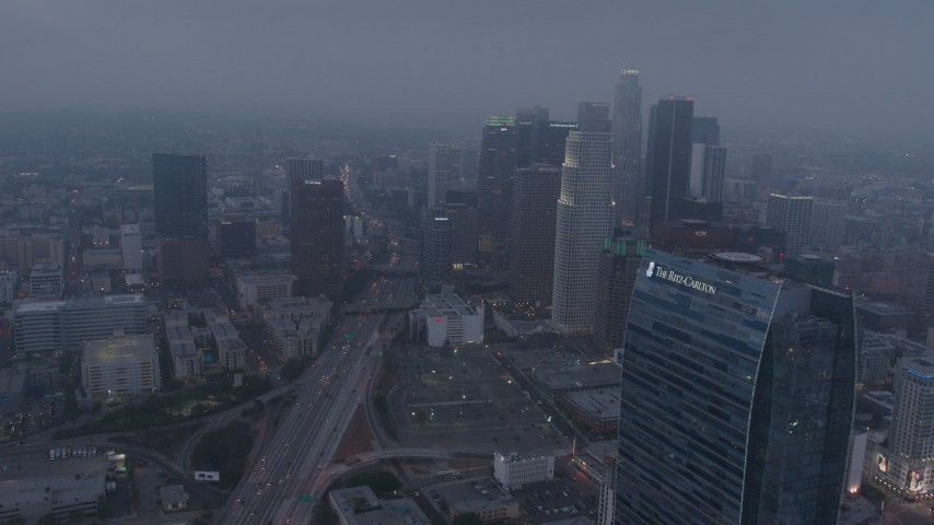 4K stock footage aerial video approaching skyscrapers below marine layer, Downtown Los Angeles, twilight Aerial Stock Footage | AX44_048