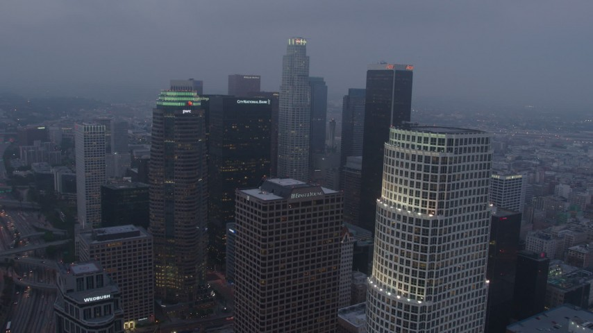 4K stock footage aerial video flying by skyscrapers, Downtown Los Angeles, twilight Aerial Stock Footage | AX44_049