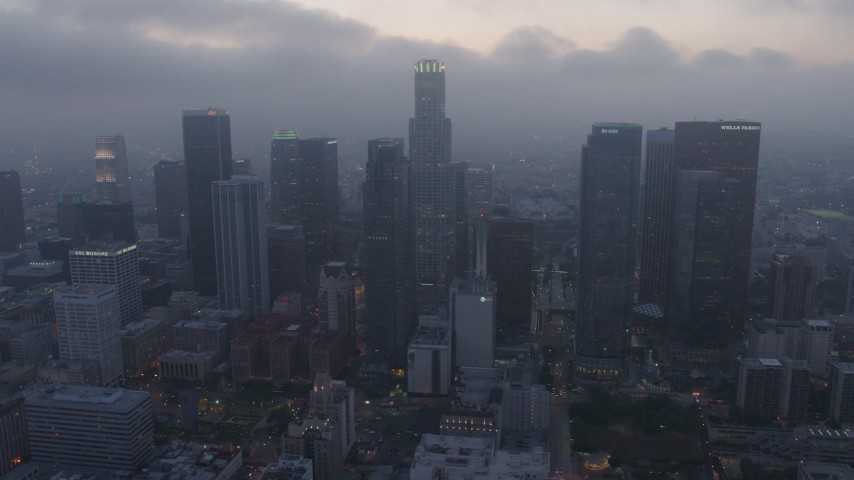 4K stock footage aerial video of a marine layer hanging over skyscrapers, Downtown Los Angeles, twilight Aerial Stock Footage | AX44_051