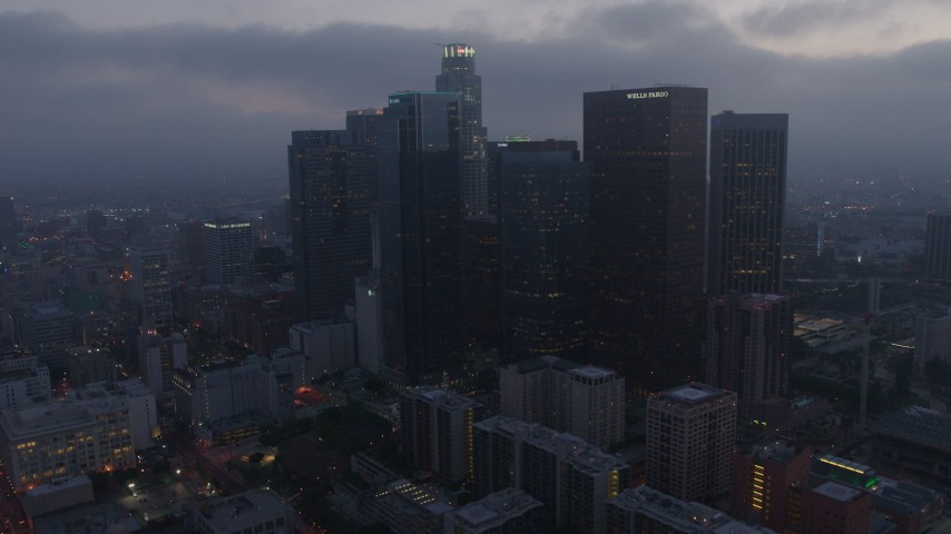 4K stock footage aerial video approaching City Hall and revealing skyline, Downtown Los Angeles, twilight Aerial Stock Footage | AX44_053