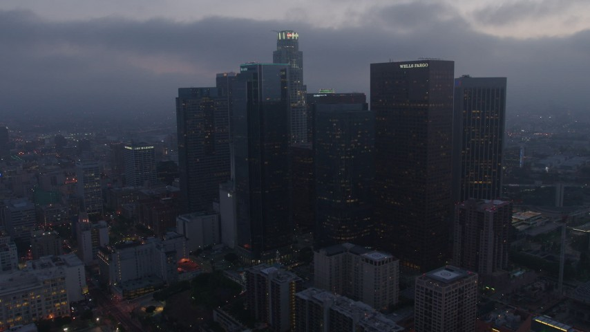 4K stock footage aerial video approaching and tilting down on US Bank Tower, Downtown Los Angeles, twilight Aerial Stock Footage | AX44_054
