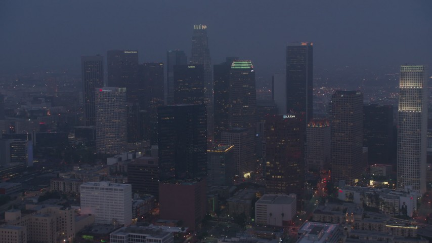 4K aerial video approaching city through marine layer, Downtown Los Angeles, night Aerial Stock Footage | AX44_057