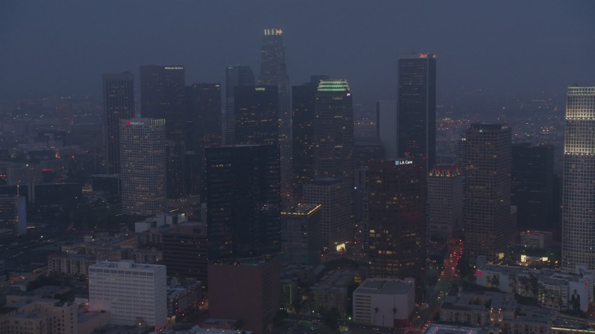 4K stock footage aerial video approaching skyscrapers, Downtown Los Angeles, night Aerial Stock Footage | AX44_058