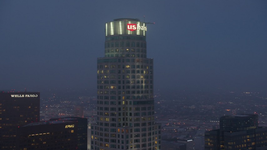 4K stock footage aerial video orbiting top of US Bank Tower, Downtown Los Angeles, night Aerial Stock Footage | AX44_059