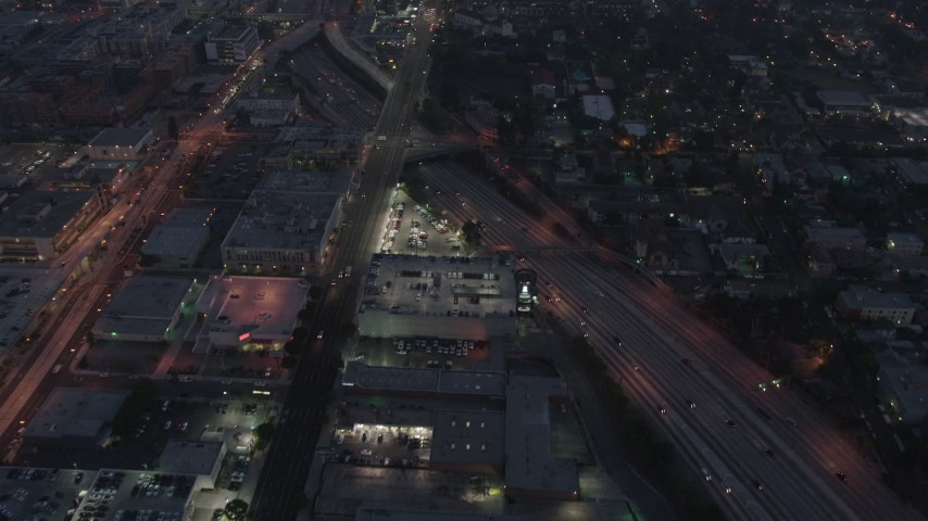 4K aerial video flying over light traffic on an interstate, Los Angeles, night Aerial Stock Footage | AX44_061