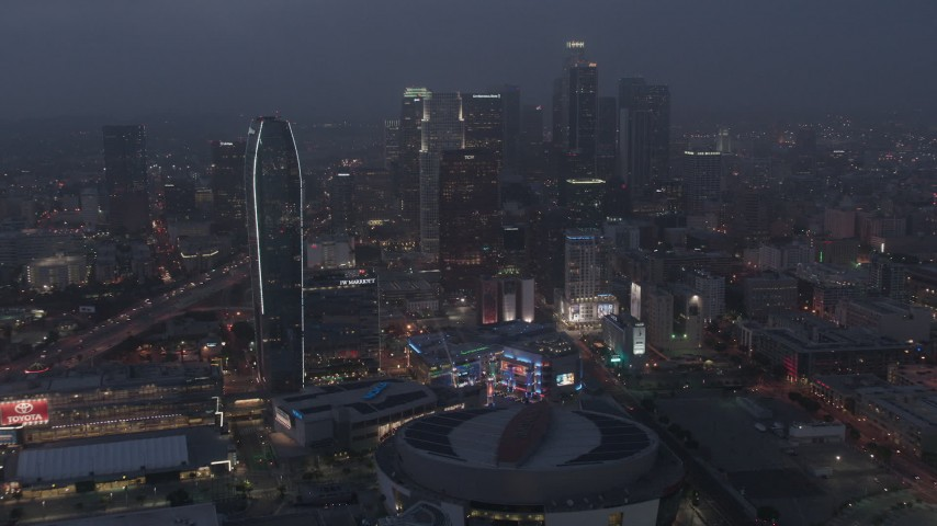 4K stock footage aerial video approaching skyscrapers and high-rises, Downtown Los Angeles, night Aerial Stock Footage | AX44_063