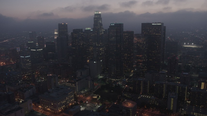 4K stock footage aerial video approaching Downtown Los Angeles skyline below marine layer, night Aerial Stock Footage | AX44_068