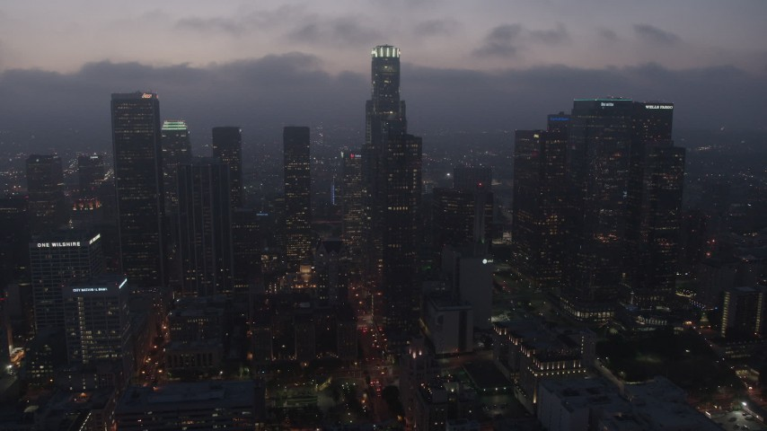 4K aerial video flying by skyscrapers under marine layer, Downtown Los Angeles, night Aerial Stock Footage AX44_069