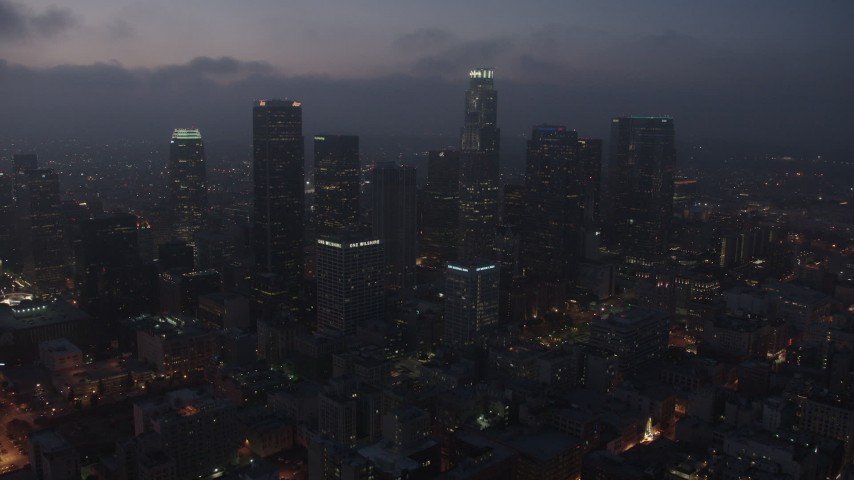 4K stock footage aerial video flying by skyscrapers below marine layer, Downtown Los Angeles, night Aerial Stock Footage | AX44_070