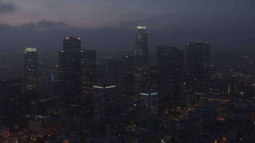 4K stock footage aerial video flying by skyscrapers below marine layer, Downtown Los Angeles, night Aerial Stock Footage | AX44_071