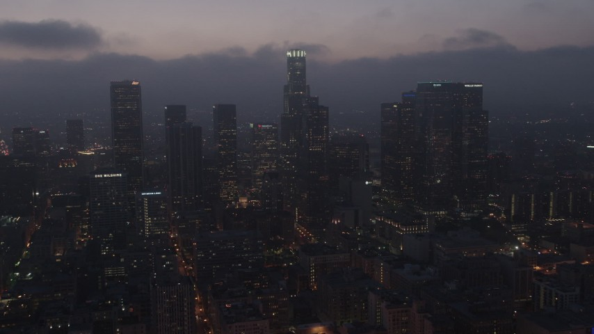 4K stock footage aerial video flying by skyscrapers below marine layer, Downtown Los Angeles, night Aerial Stock Footage | AX44_072
