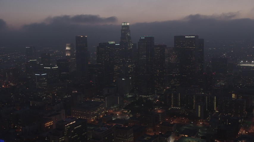 4K stock footage aerial video flying by skyscrapers below marine layer, Downtown Los Angeles, sunset Aerial Stock Footage | AX44_073