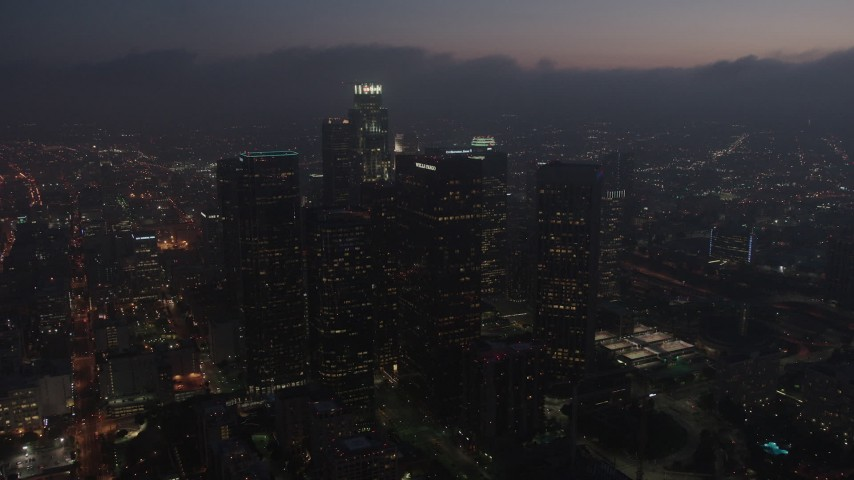4K stock footage aerial video flying by skyscrapers tracking US Bank Tower, Downtown Los Angeles, night Aerial Stock Footage | AX44_074