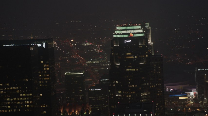 4K stock footage aerial video of a medium shot flying by skyscrapers, Downtown Los Angeles, night Aerial Stock Footage | AX44_077