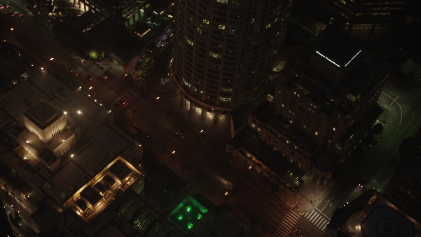 4K stock footage aerial video of city streets and buildings, Downtown Los Angeles, night Aerial Stock Footage | AX44_081