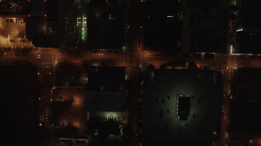 4K stock footage aerial video of a bird's eye following city streets and buildings, Downtown Los Angeles. night Aerial Stock Footage | AX44_085