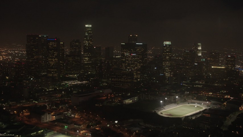 4K aerial video closing in on skyline, Downtown Los Angeles, night Aerial Stock Footage | AX44_089