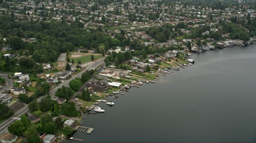 5K stock footage aerial video flying by lakefront homes, Rainier Beach, Washington Aerial Stock Footage | AX45_001