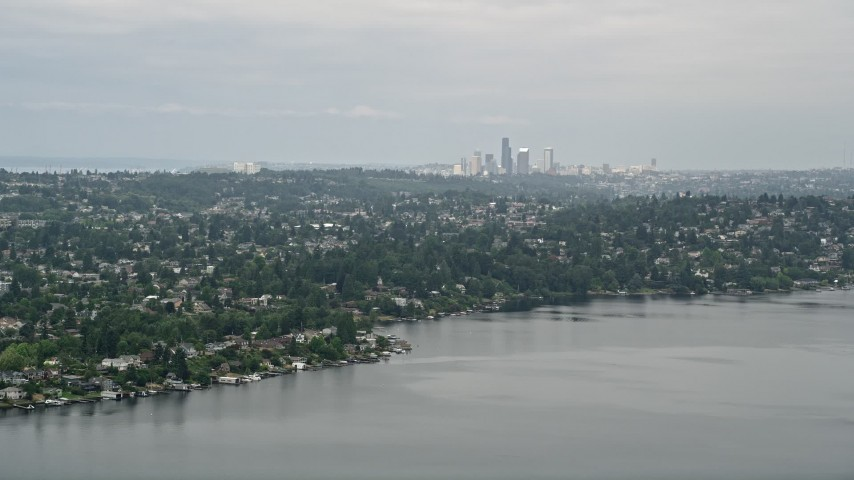 5K stock footage aerial video of skyline seen from lakefront homes, Rainier Beach, Seattle, Washington Aerial Stock Footage | AX45_002