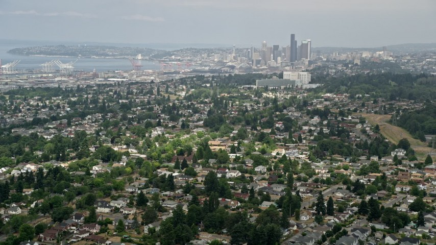 5K stock footage aerial video of Seattle skyline seen from residential neighborhoods, Beacon Hill, Seattle, Washington Aerial Stock Footage | AX45_009