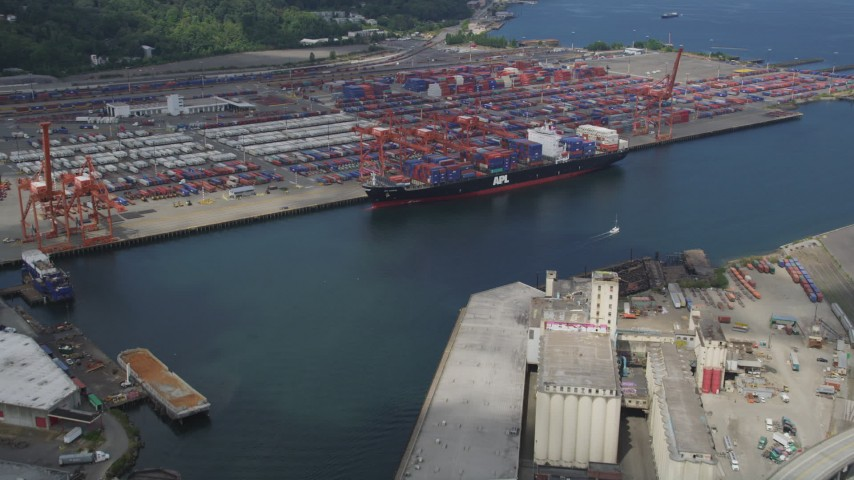 5K stock footage aerial video approaching a cargo ship loading containers at Port of Seattle, Washington Aerial Stock Footage | AX45_016