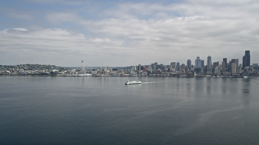 5K stock footage aerial video tracking a ferry sailing across Elliott Bay near Downtown Seattle, Washington Aerial Stock Footage | AX45_020