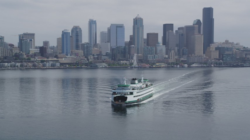5K stock footage aerial video tracking a ferry sailing away from Downtown Seattle skyline, Washington Aerial Stock Footage | AX45_021