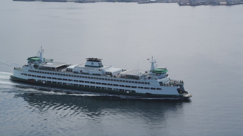 5K stock footage aerial video tracking a ferry crossing Elliott Bay, Seattle, Washington Aerial Stock Footage | AX45_022