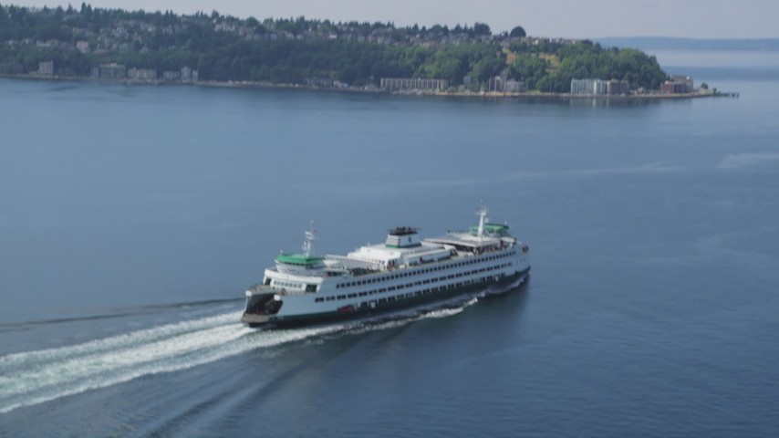 5K stock footage aerial video tracking a ferry sailing across Elliott Bay, Seattle, Washington Aerial Stock Footage | AX45_023
