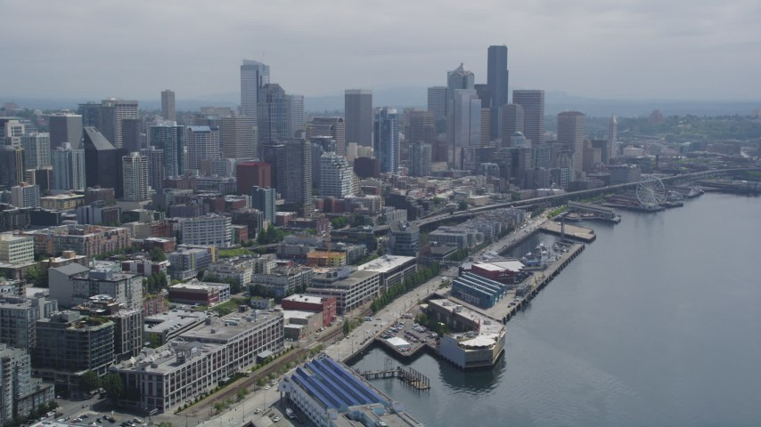 5K stock footage aerial video of Downtown Seattle skyline seen from Elliott Bay, Seattle, Washington Aerial Stock Footage AX45_030
