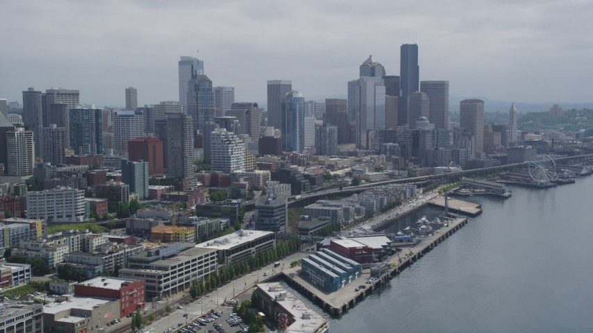 5K stock footage aerial video of Downtown Seattle skyline seen from the Waterfront on Elliott Bay, Washington Aerial Stock Footage AX45_031