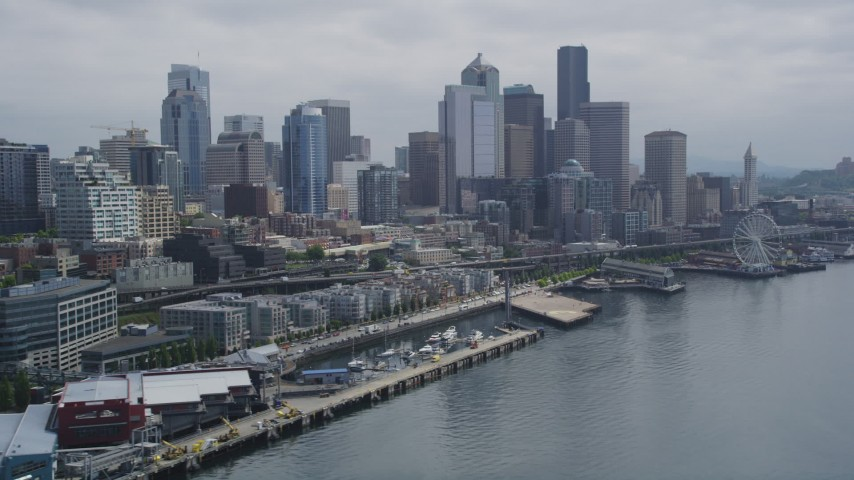 5K stock footage aerial video of Downtown Seattle skyline and Central Waterfront seen from Elliott Bay, Washington Aerial Stock Footage | AX45_032
