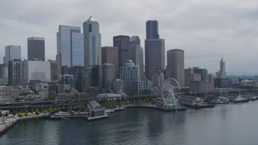 5K stock footage aerial video flying by skyline and the Seattle Great Wheel on Pier 57, Downtown Seattle, Washington Aerial Stock Footage | AX45_033